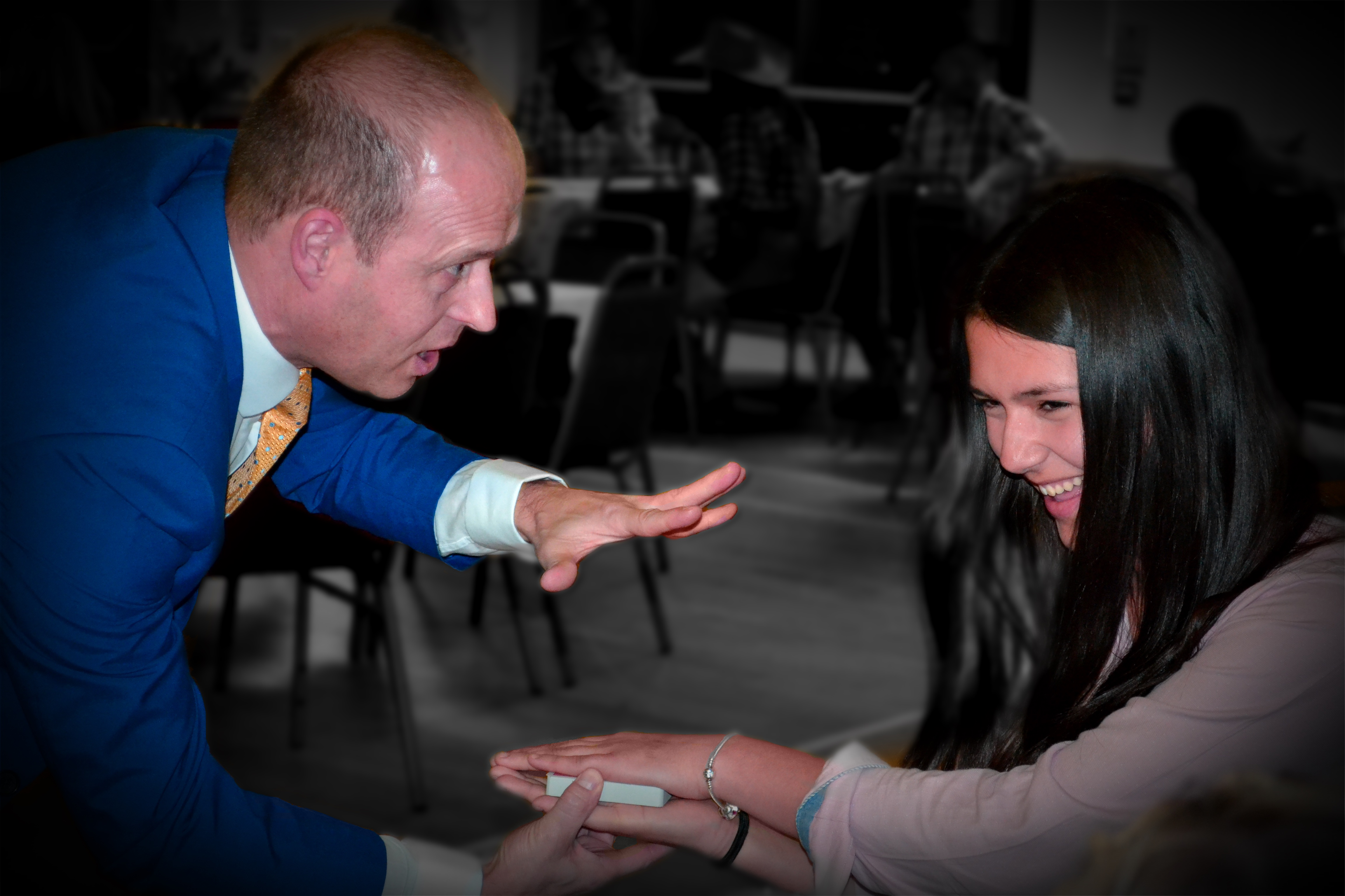 Wedding magician doing a card trick